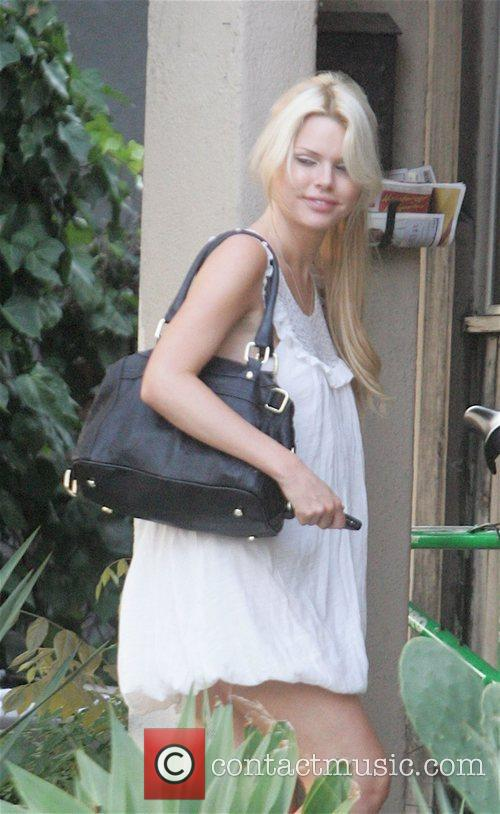 Sophie Monk arrives at a house in West...