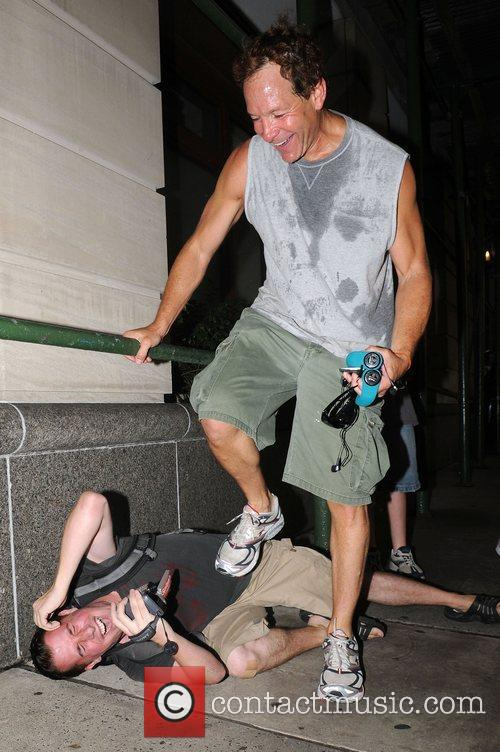 Steve Guttenberg has some fun with the paps...