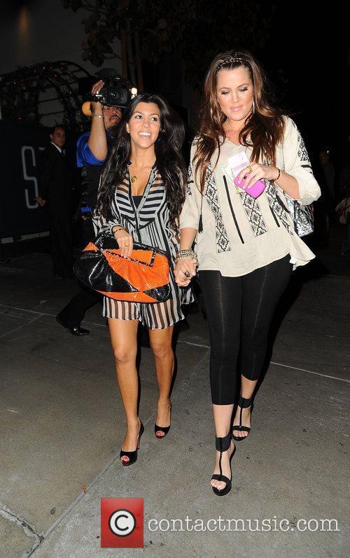 Kourtney Kardashian and Khloe Kardashian outside STK restaurant...