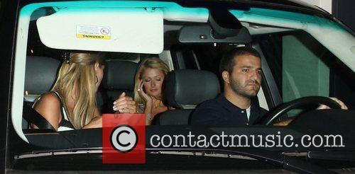 Nicky Hilton, Paris Hilton and David Katzenburg outside...