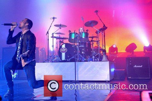 Singer Scott Wieland and Drummer Eric Kretz of...