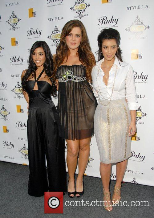 Kourtney Kardashian, Khloe Kardashian and Kim Kardashian 9