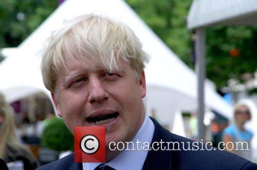 The Mayor of London, Boris Johnson, cuts the...