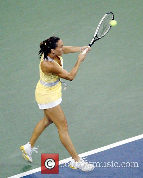Jelena Jankovic plays a shot during the Women's...