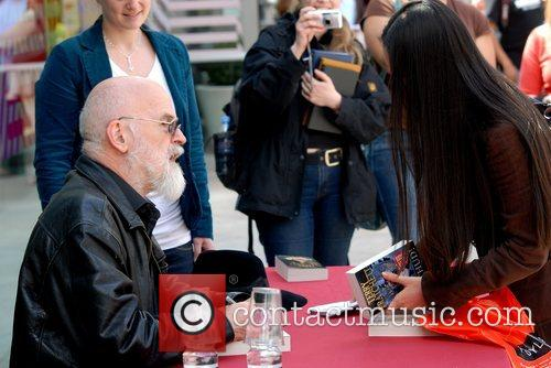 Terry Pratchett signing copies of his book 'Making...