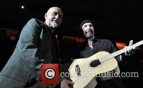 The Edge presents Peter Gabriel with Amnesty International's...