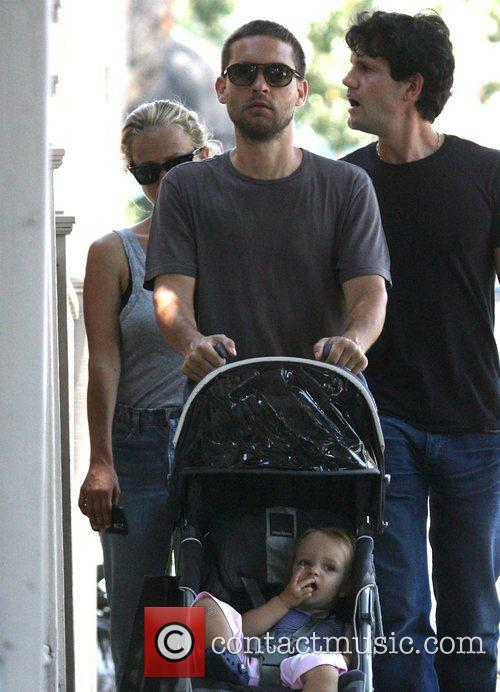 Tobey Maguire, his wife Jennifer Meyer and their...
