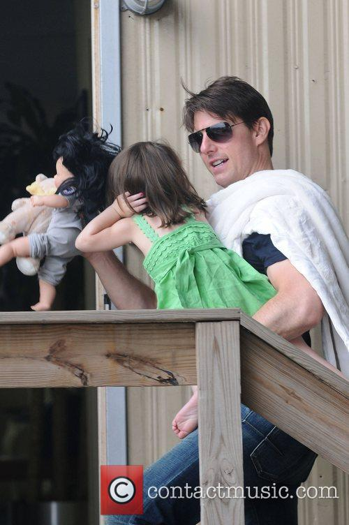 Tom Cruise with daughter Suri Cruise catch a...