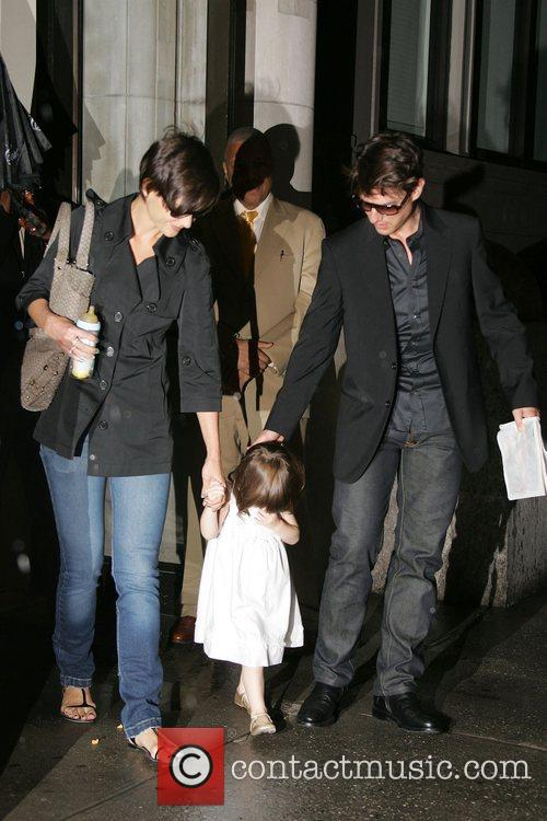 Tom Cruise and Katie Holmes with daughter Suri...