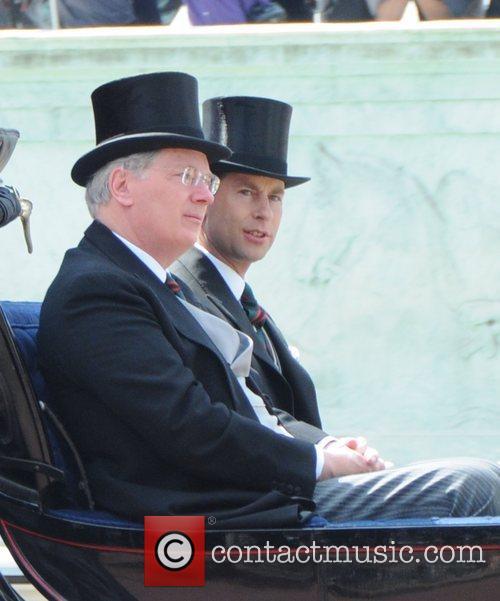 Prince Edward rides the coach through the Mall...