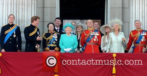 Members of the Royal Family stand on the...