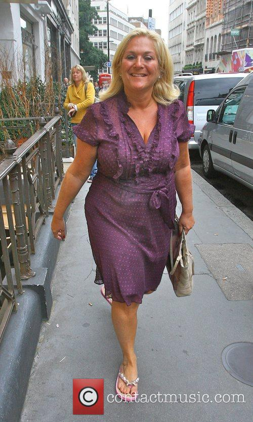 Vanessa Feltz wearing a purple dress and flip-flops...