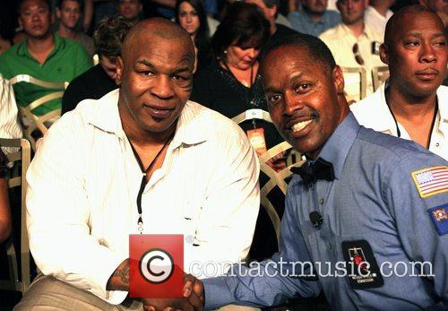 Mike Tyson and referee Kenny Bayless at the...