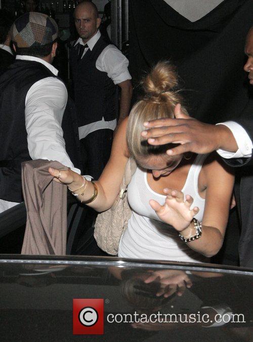 Bar Refaeli hides her face as she leaves...