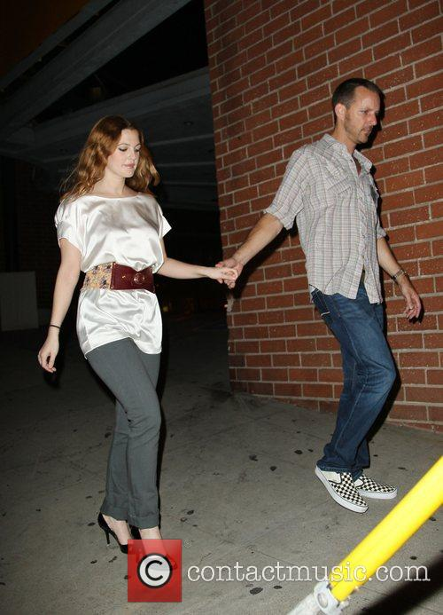 Drew Barrymore and a male friend leaving the...