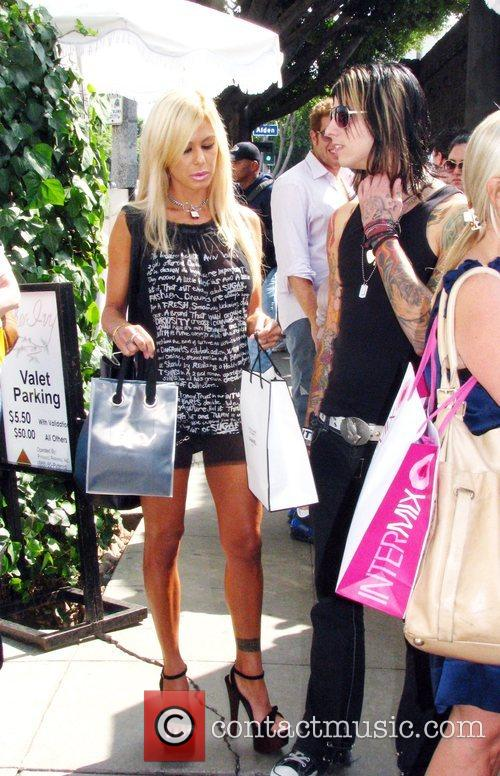Shauna Sand and a male friend shopping on...