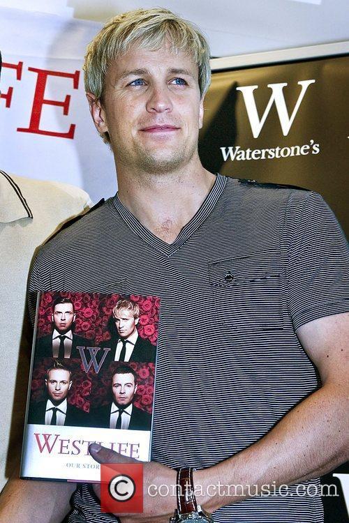 Kian Egan Westlife sign copies of their new...