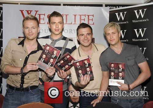 Westlife sign copies of their new autobiography 'Westlife...