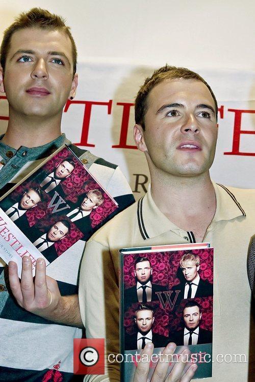 Mark Feehily and Shane Filan Westlife sign copies...