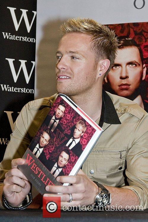 Nicky Byrne Westlife sign copies of their new...