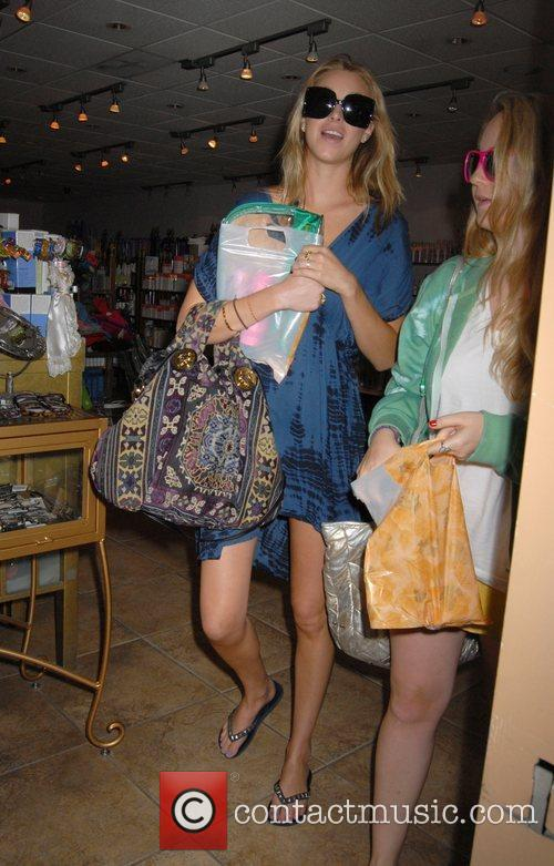 Whitney Port shopping at Avant Garde with a...