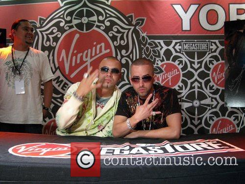 Wisin and Yandel  sign copies of their...
