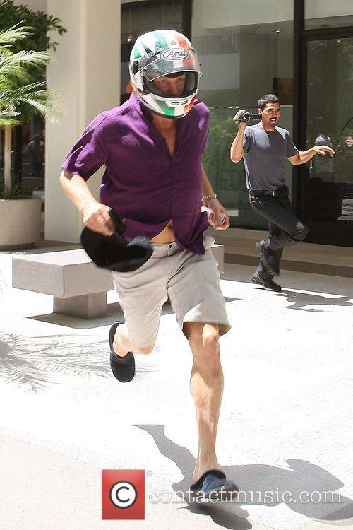 Woody Harrelson running from the Newsroom Cafe to...