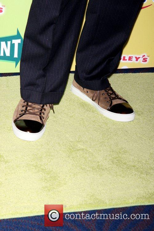 Shows off his shoes at the debut of...