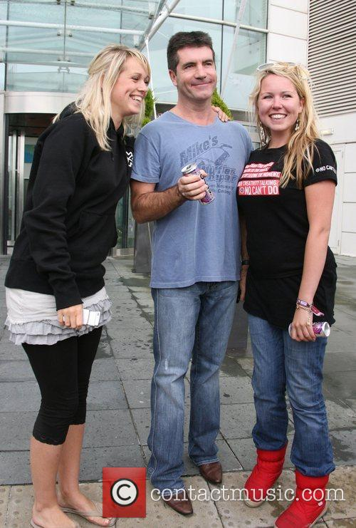 Simon Cowell with fans X Factor judges leave...