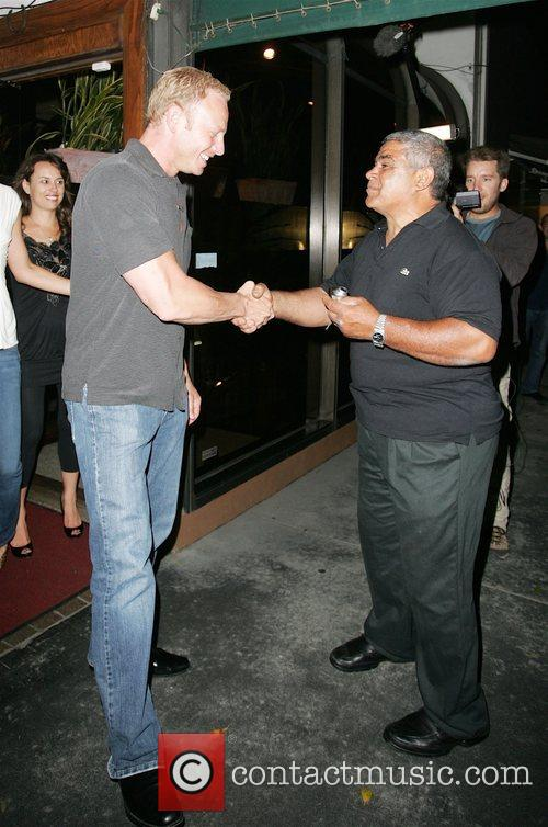 Yaya Mohamed shakes hands with Ian Ziering whilst...