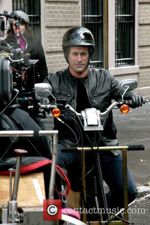 Tina Fey and Jon Hamm filming a scene...