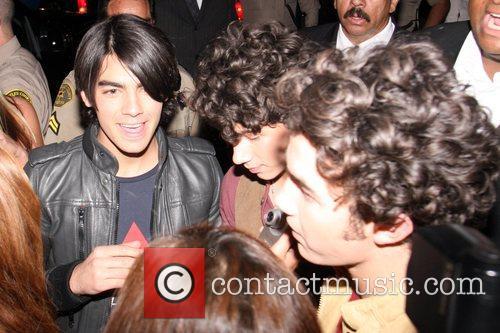 Joe Jonas, Nick Jonas and Kevin Jonas of...