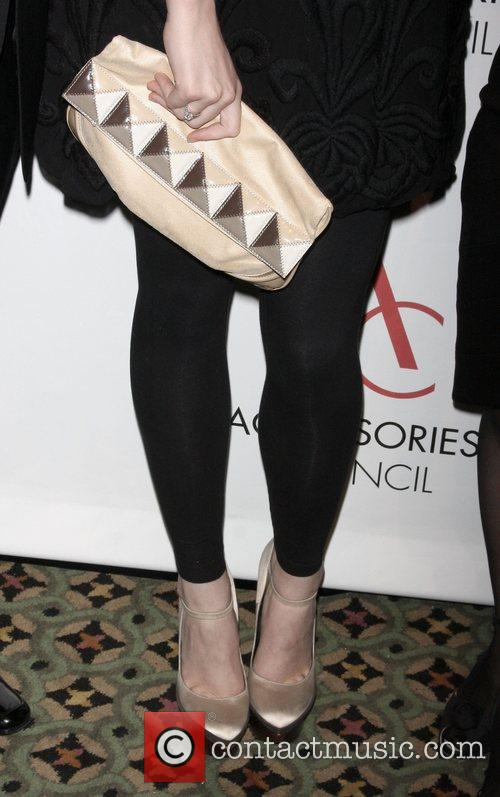 Coco Rocha shows off her shoes and purse...