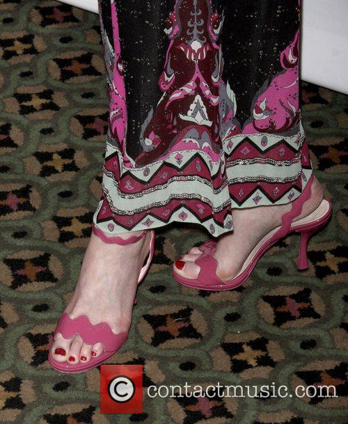 Dana Delany shows off her shoes at the...