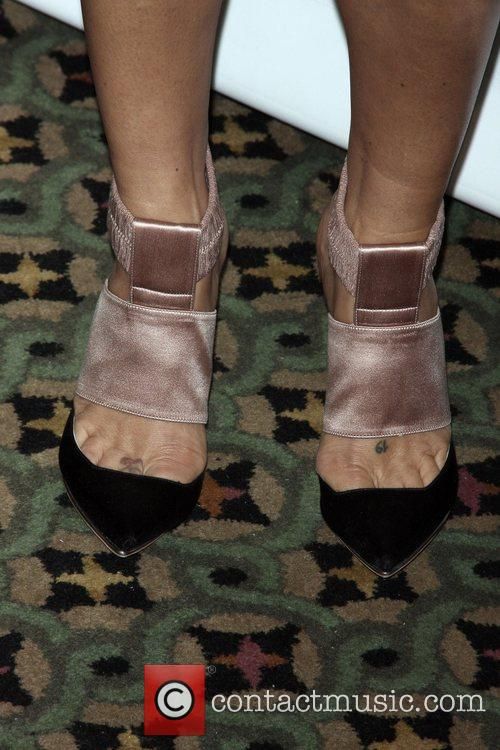 Helena Christensen shows off her shoes at the...