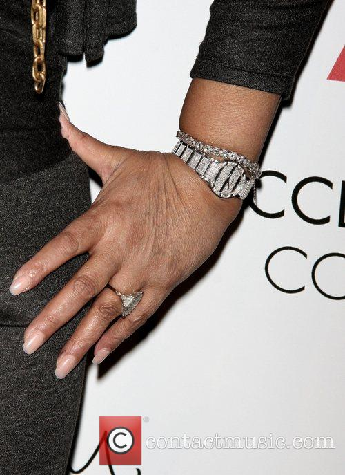 Tina Knowles shows off her jewelry at the...