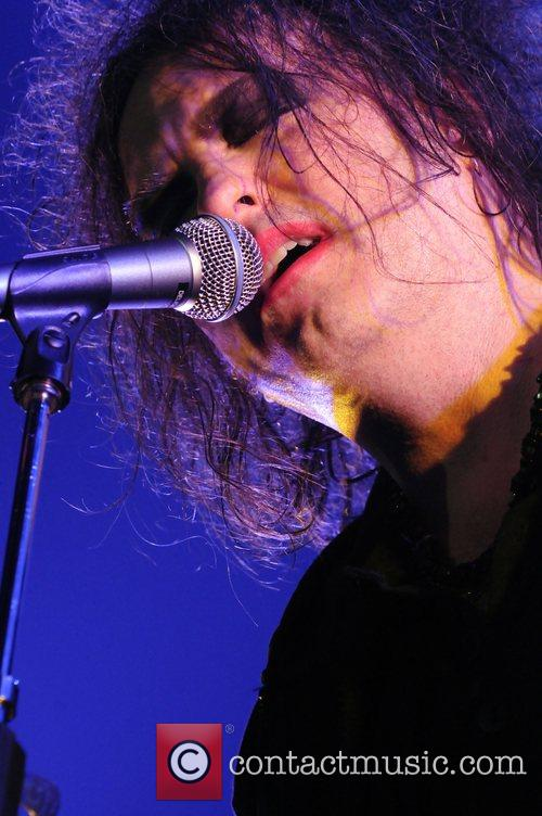 Robert Smith performing live with The Cure KROQ-FM...