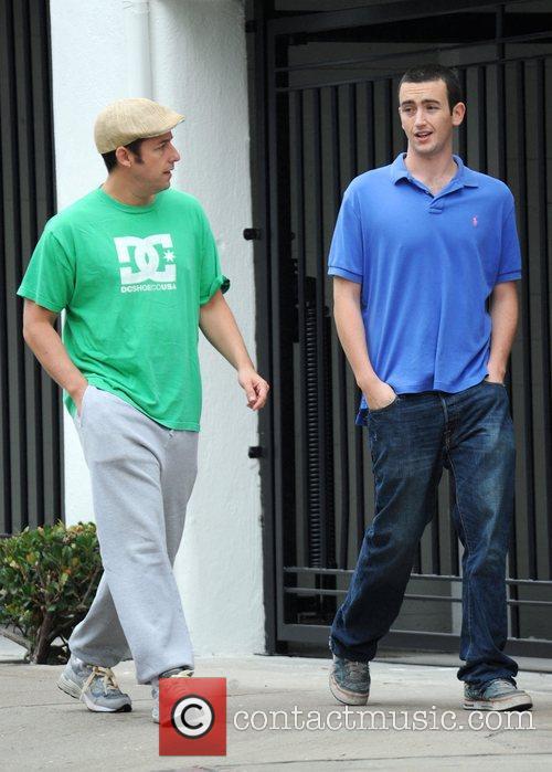 Adam Sandler chats to a friend as he...