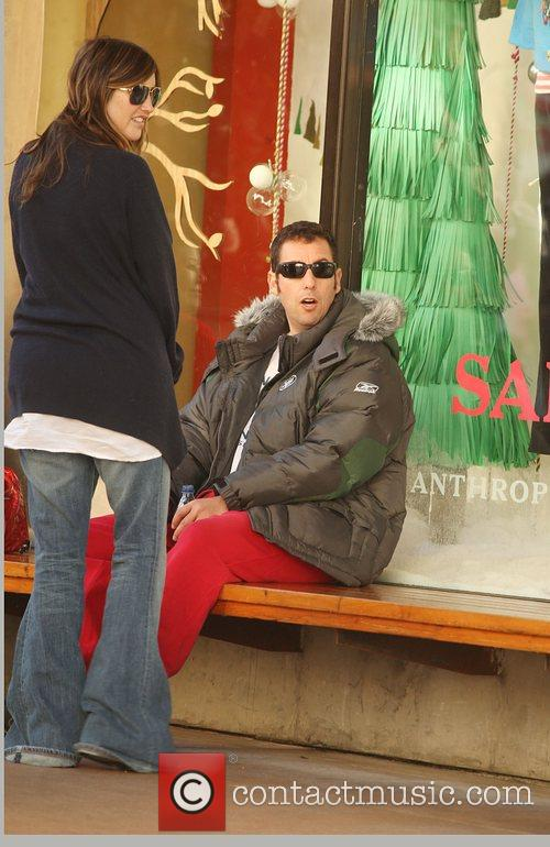 Adam Sandler  and his family shopping at...