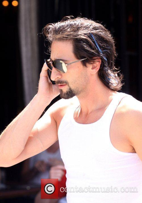 Actor Adrien Brody strips down to his vest...
