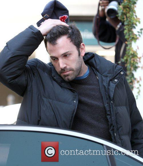 Ben Affleck looks unhappy when picking up his...