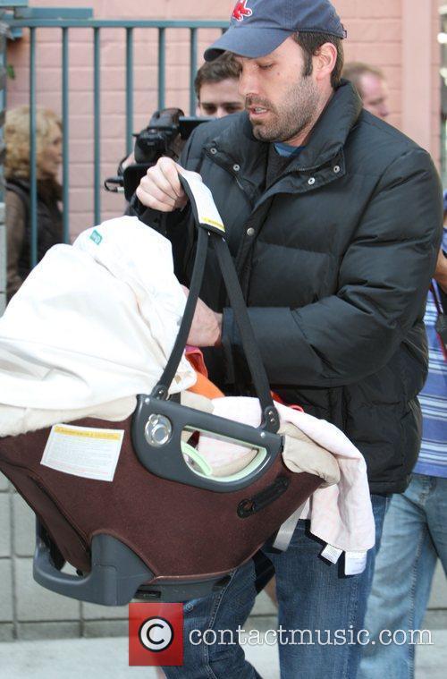Ben Affleck carrying his baby daughter Seraphina Affleck...
