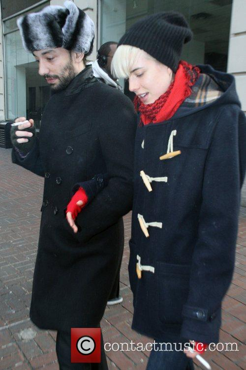 Agyness Deyn wraps up against the cold while...