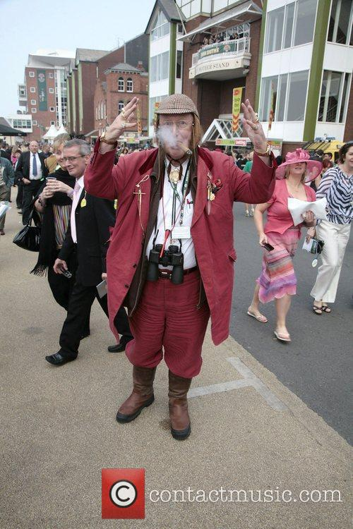 John McCririck attend Ladies Day at the Grand...