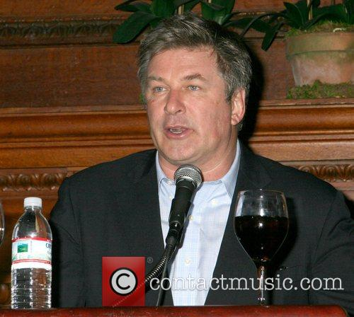 Speaks at a party for his book 'A...