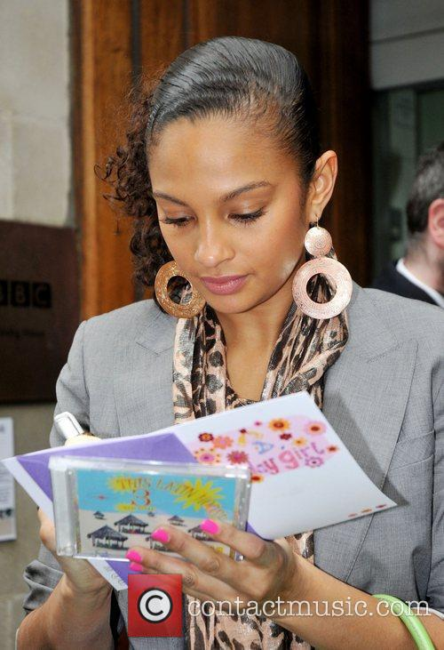Alesha Dixon  signs autographs for fans as...