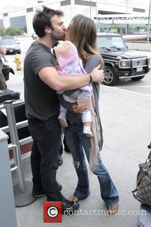 Alessandra Ambrosio and Jamie Mazur Arrive At Lax Airport With Daughter Anja Louise To Catch An American Airlines Flight 9
