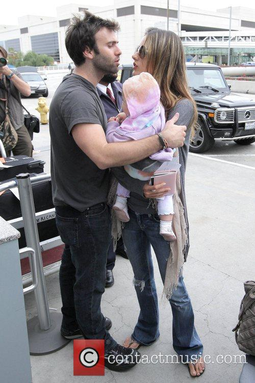 Alessandra Ambrosio and Jamie Mazur arrive at LAX airport with daughter Anja Louise to catch an American Airlines flight 5