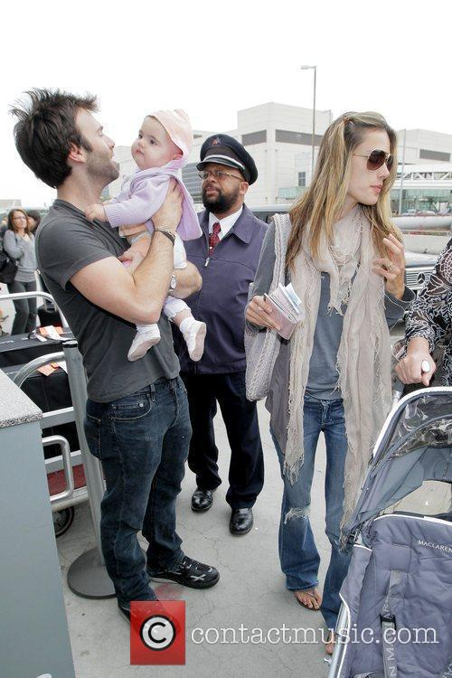Alessandra Ambrosio and Jamie Mazur arrive at LAX airport with daughter Anja Louise to catch an American Airlines flight 1