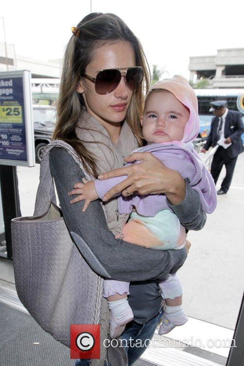 alessandra ambrosio arrives at lax airport with daughter anja louise to catch an american airlines flight 5304914